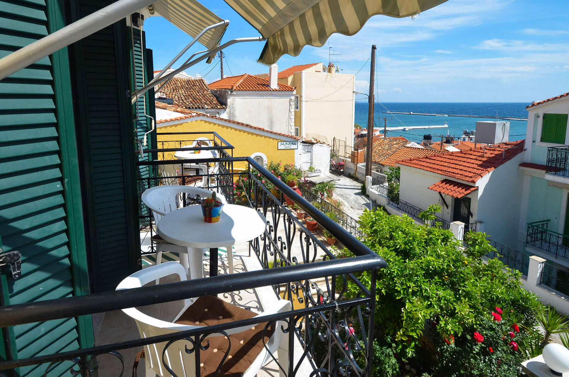 with partial sea view have 2 single beds or 1 double bed bathroom with shower balcony on first floor with a view to the green leafy gardens and some side - Garden View